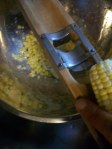 using an old-fashion hand corn-sheller